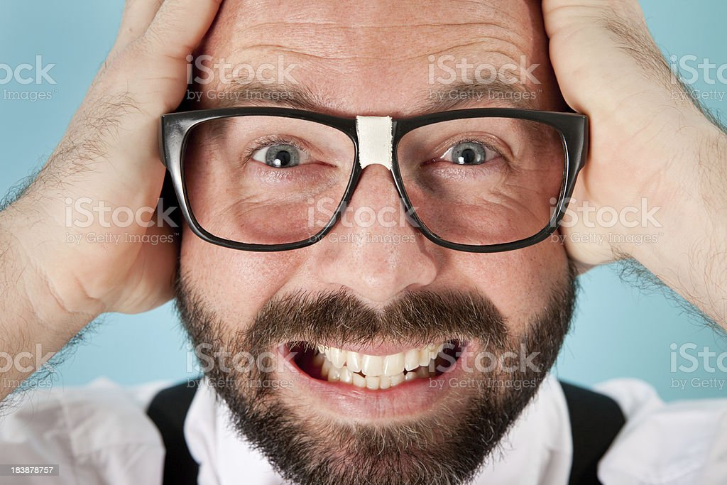 Nerdy Man with Look of Excitement, Panic, Surprise, Frustration stock photo