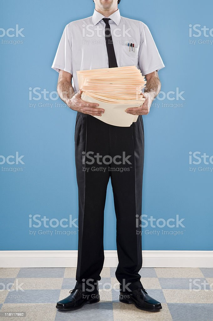 Nerdy Office Worker With Folders royalty-free stock photo