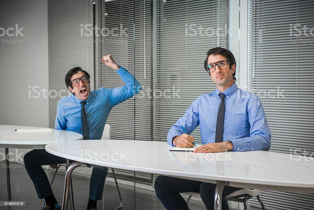 Nerdy Office Worker with Two  Personalities stock photo