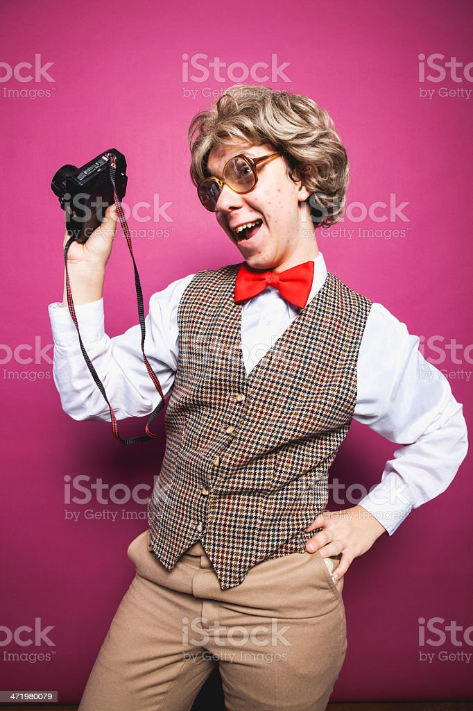 Nerdy Pink Background Photographer Student Making Silly Face royalty-free stock photo