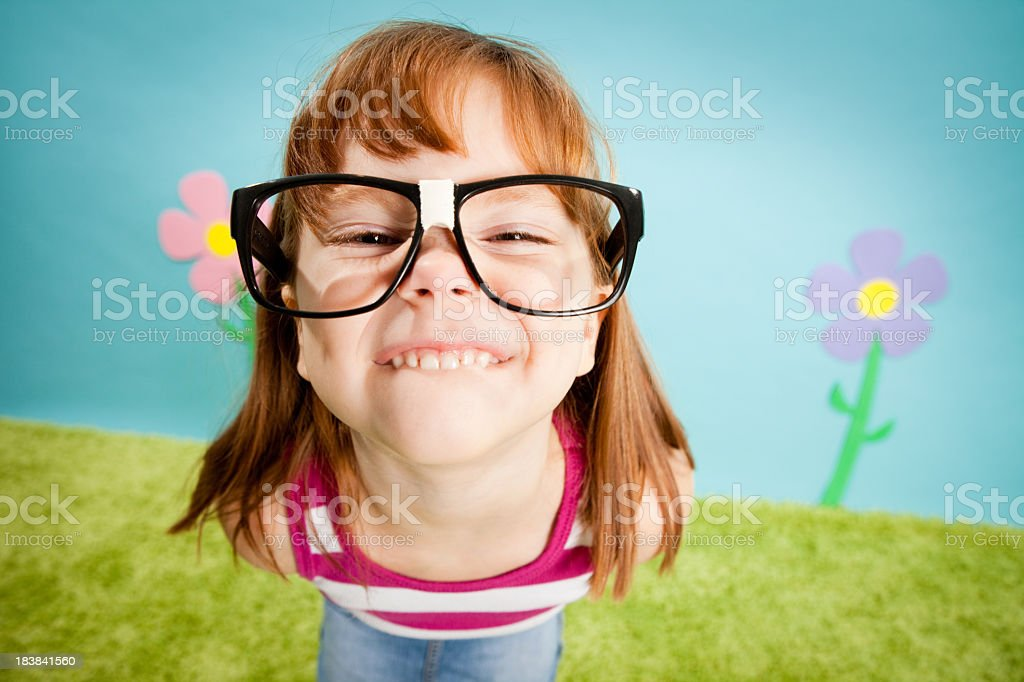 Nerdy, Red-Haired Little Girl with Cheesy Smile stock photo