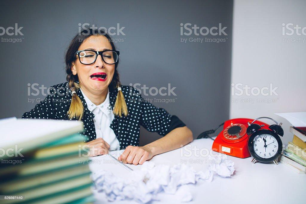 Nerdy secretary having bad day on work stock photo