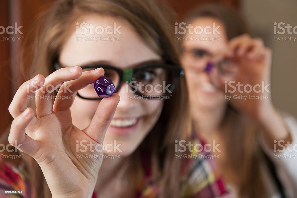 Nerdy Teens in Role Playing Dice Game stock photo