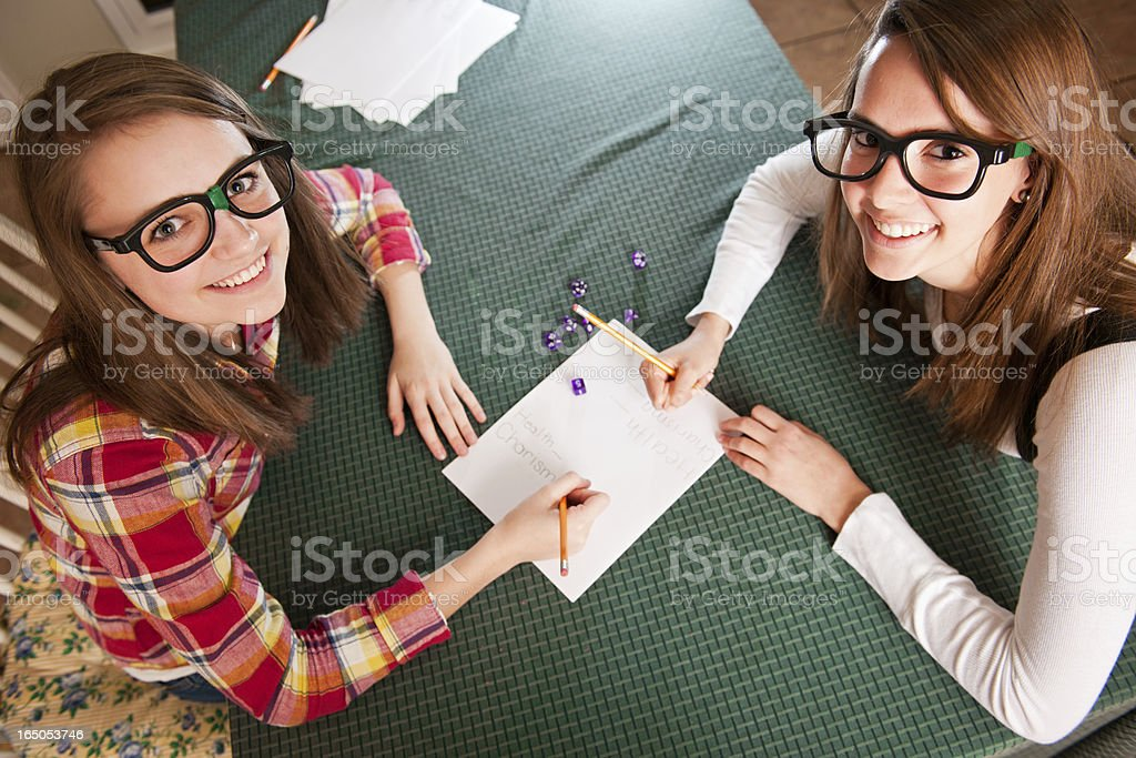 Nerdy Teens Together for Role Playing Dice Game royalty-free stock photo