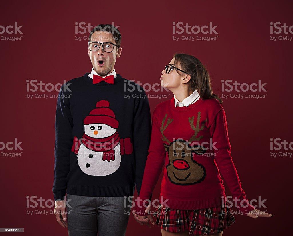Nerdy woman kissing shocked man stock photo