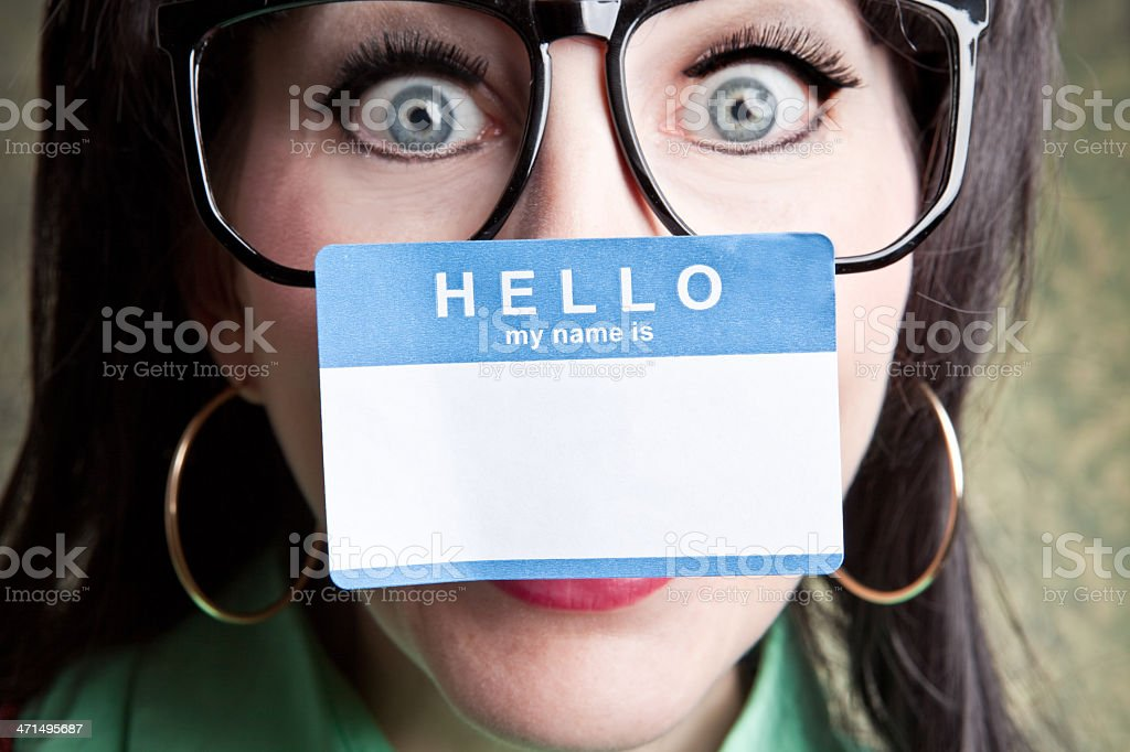 Nerdy Woman With Name Tag Stuck To Nose royalty-free stock photo