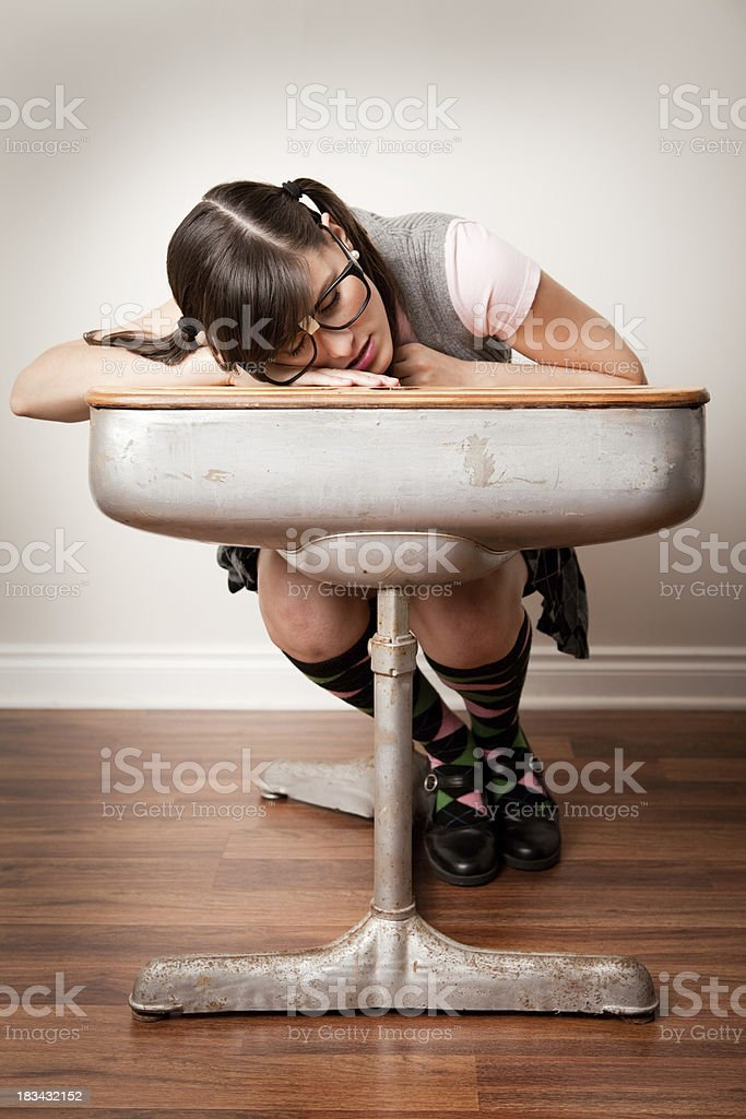 Nerdy Young Woman Student Sleeping in School Desk stock photo