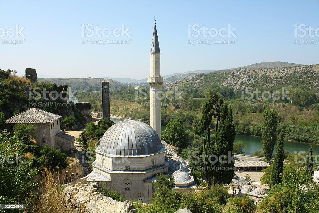 Neretva river,  Mosque Hadzi-Alija, Clock-tower, Pocitelj, Bosnia and Herzegovina stock photo