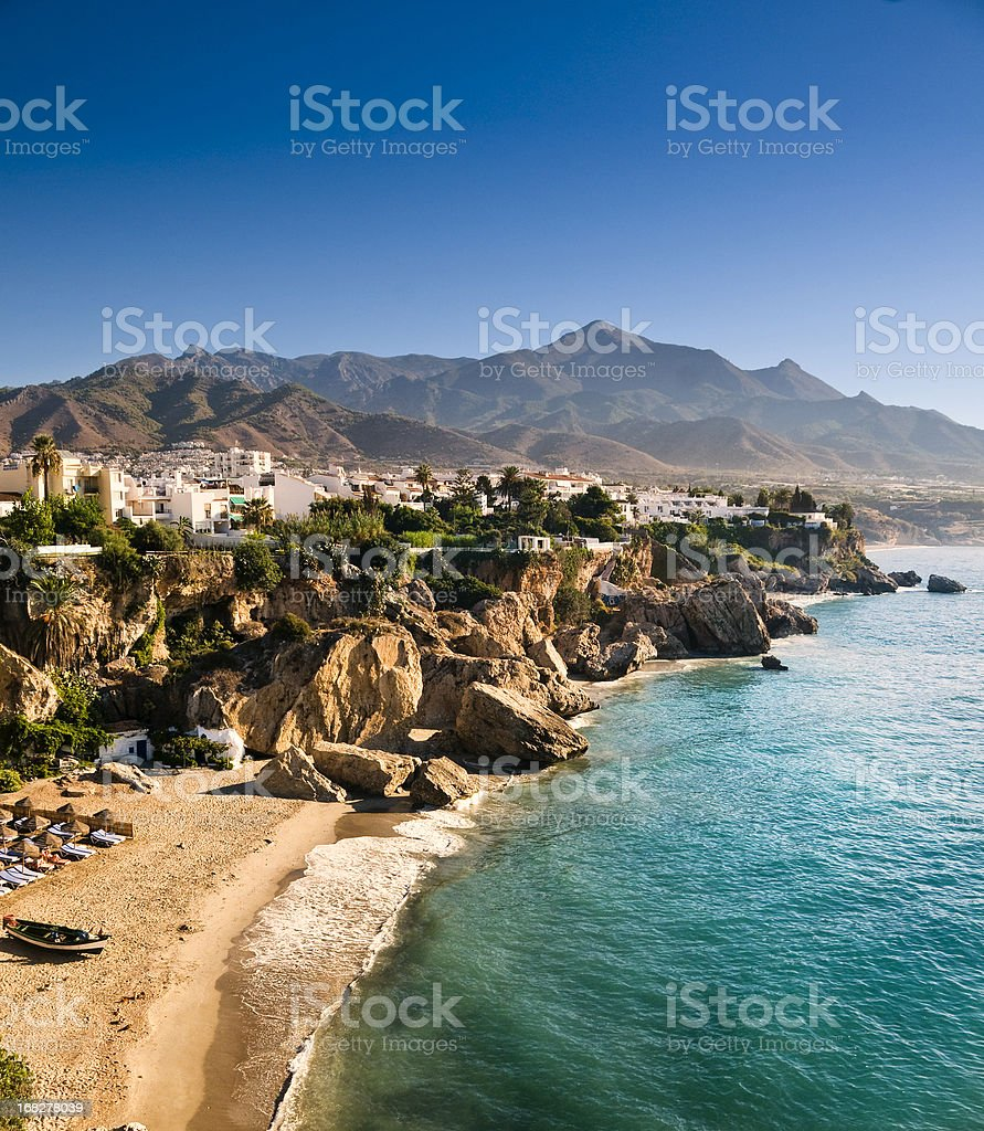 Nerja Beach at sunrise stock photo