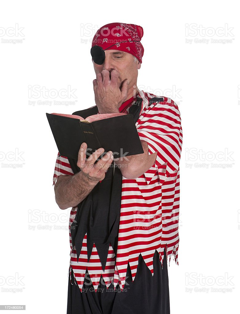 nervous bible reading pirate bites nails stock photo