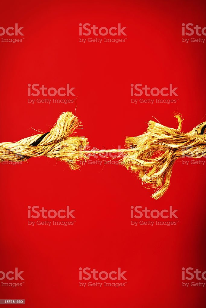 Nervous breakdown symbolized by frayed rope near snapping point royalty-free stock photo