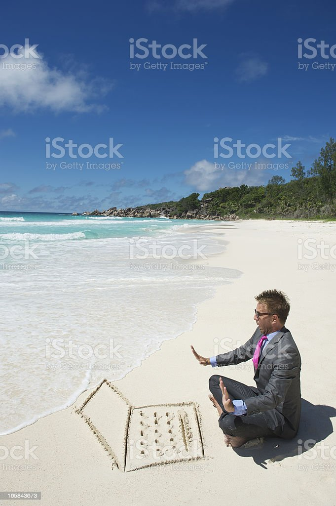 Nervous Businessman Watches Wave Approach Beach Laptop royalty-free stock photo
