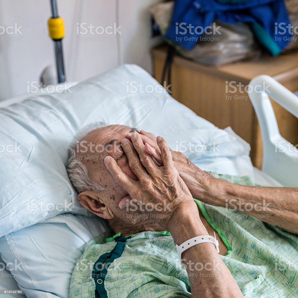 Nervous Elderly Man Hospital Patient Covering Face With Hands stock photo