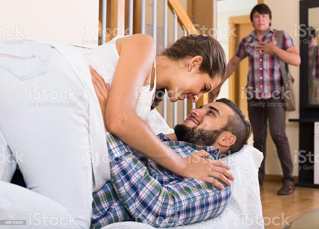Nervous husband watching flirting spouse stock photo