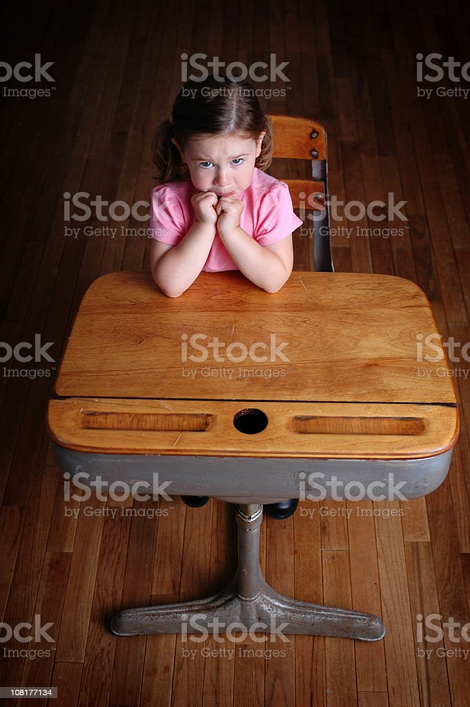 Nervous Little Girl in School Desk royalty-free stock photo