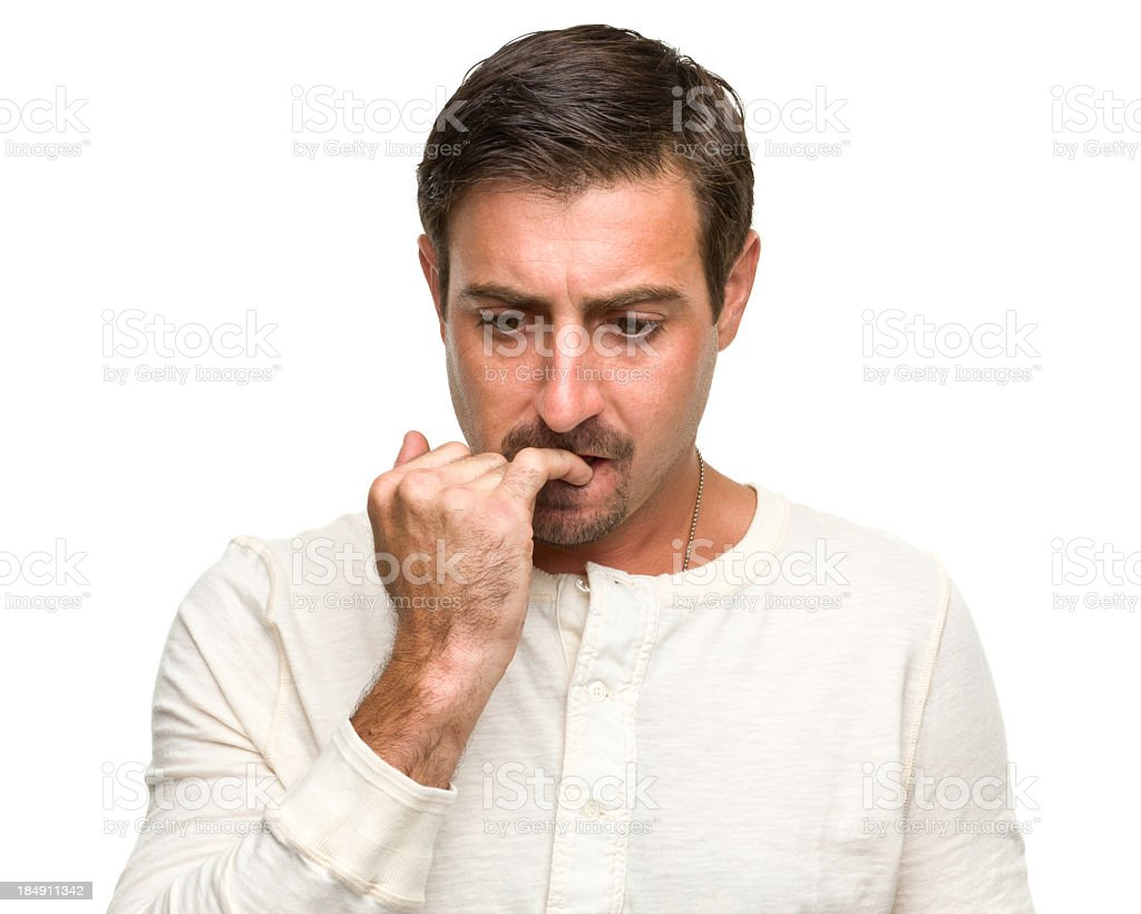 Nervous Man Bites Fingernail stock photo