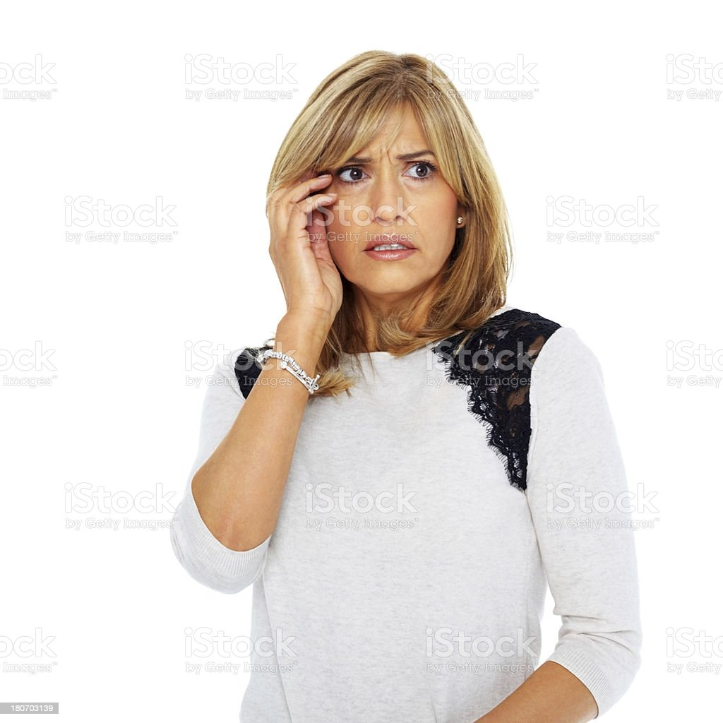 Nervous mature woman looking at copyspace royalty-free stock photo