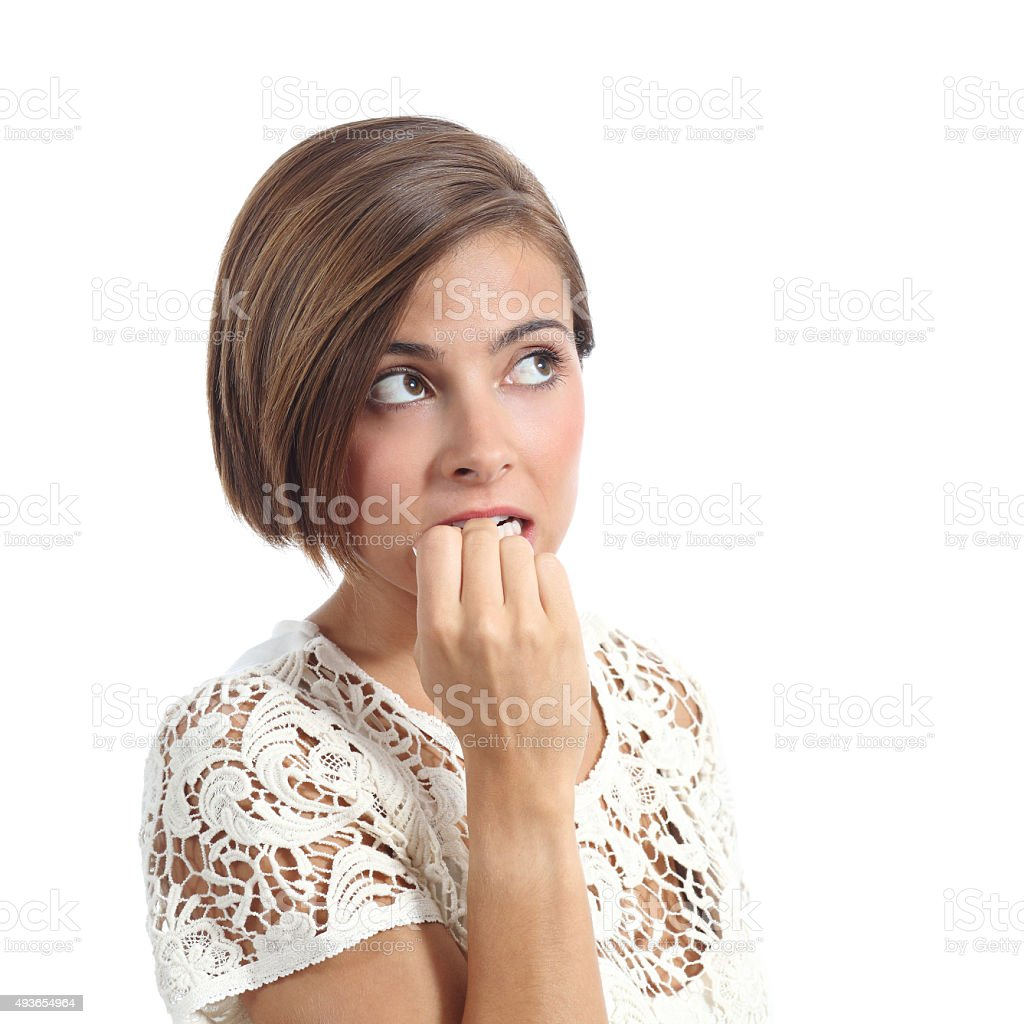 Nervous pensive woman biting nails stock photo