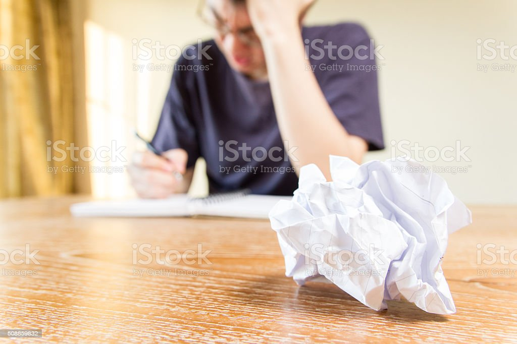 nervous stress thinking man writing stock photo