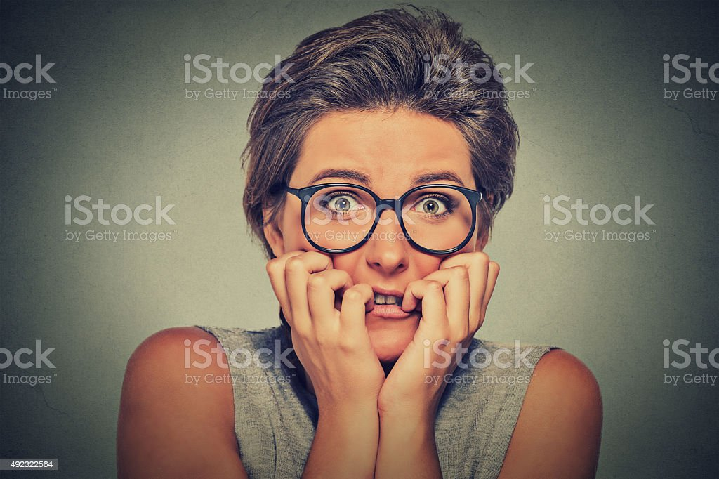 nervous stressed anxious woman with glasses stock photo