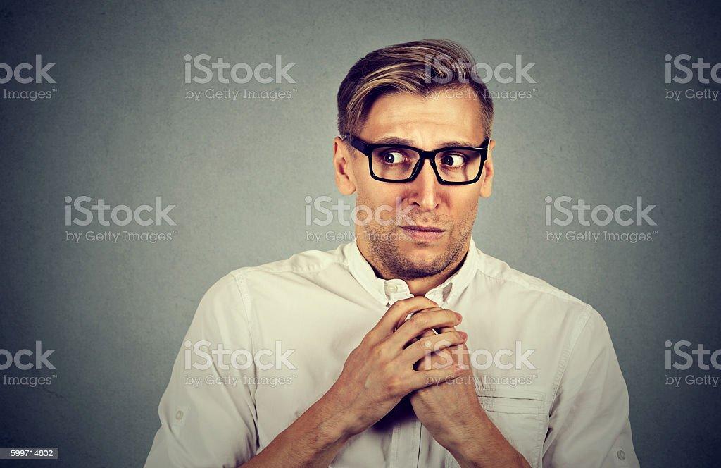 Nervous stressed man feels awkward anxious stock photo