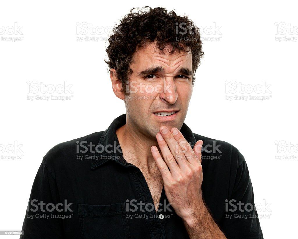 Nervous Uncertain Young Man Grimacing stock photo