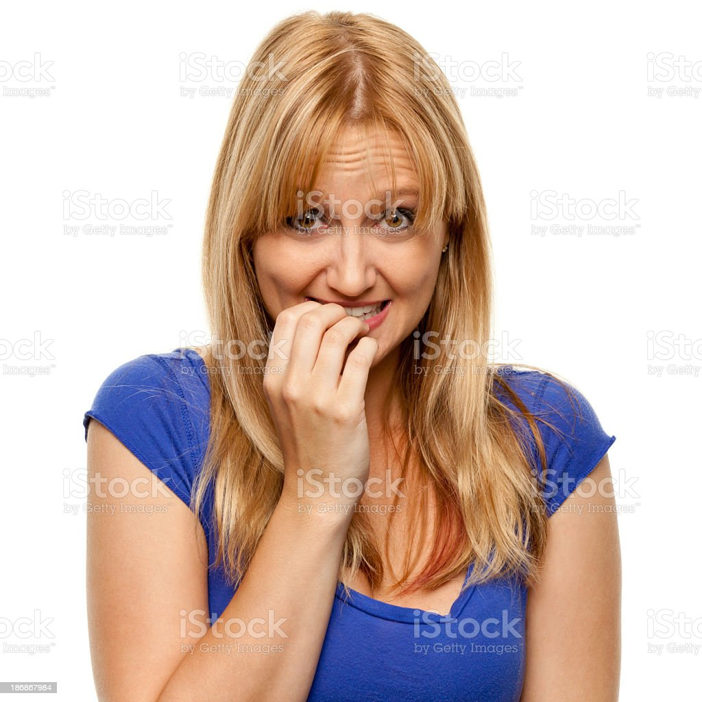 Nervous Woman Biting Fingernails stock photo