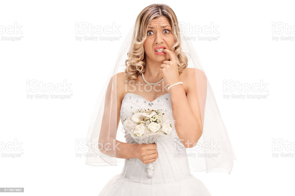 Nervous young bride biting her nails stock photo