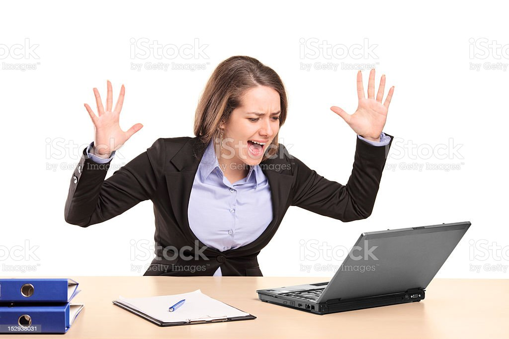 Nervous young businesswoman yelling royalty-free stock photo