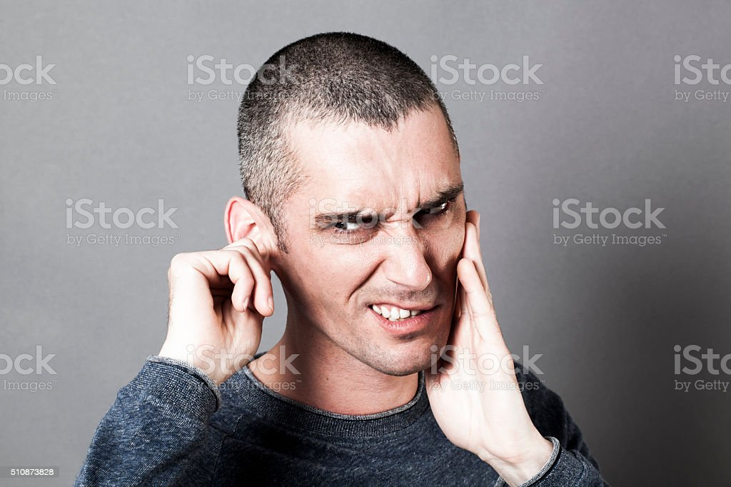 nervous young man suffering from toothache or earache stock photo