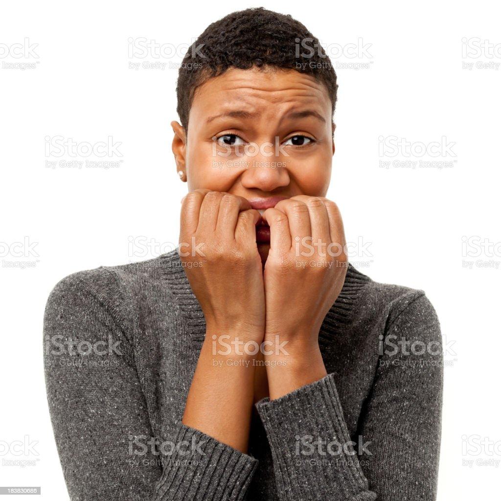 Nervous Young Woman Bites Fingernails stock photo
