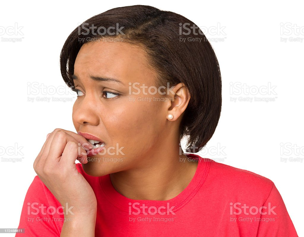 Nervous Young Woman Biting Fingernails royalty-free stock photo