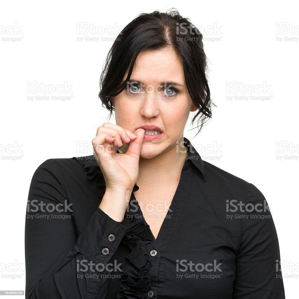 Nervous Young Woman Biting Nail royalty-free stock photo