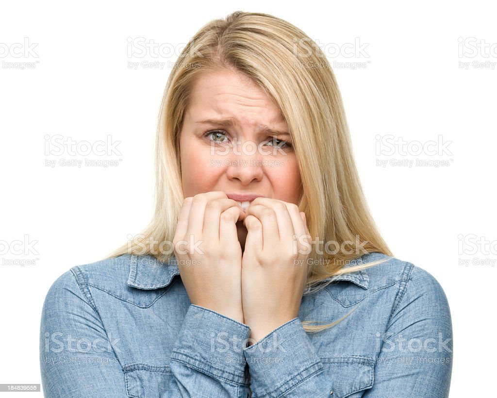 Nervous Young Woman Biting Nails royalty-free stock photo