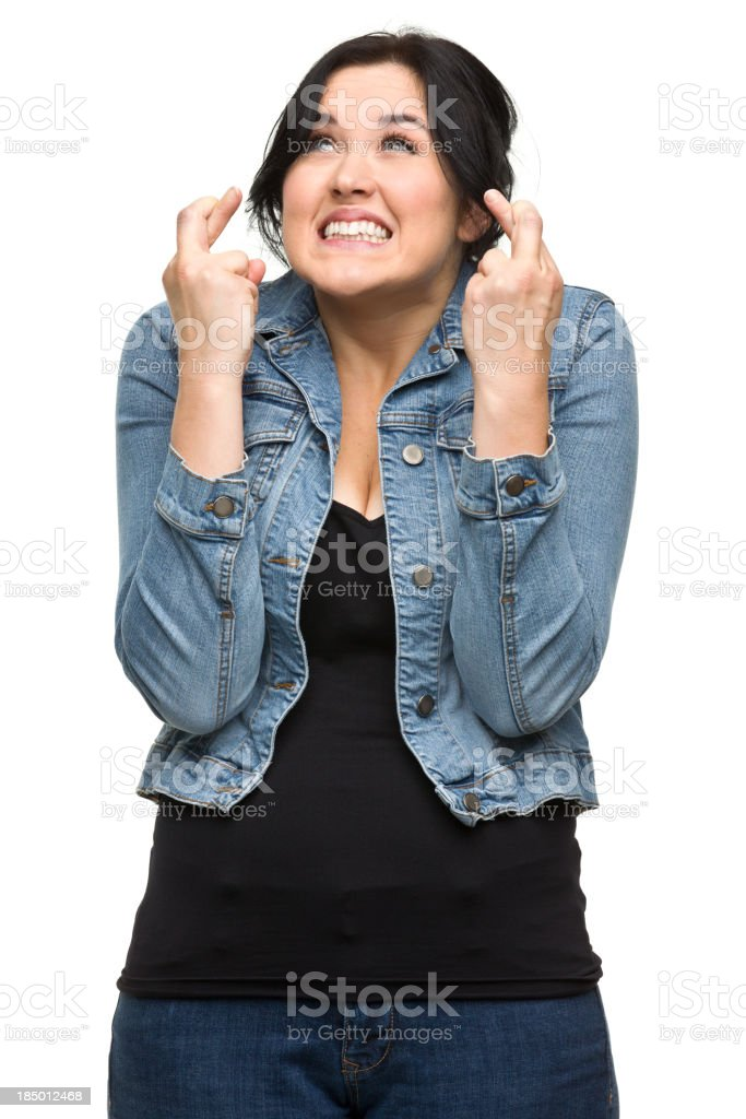 Nervous Young Woman Crosses Fingers stock photo
