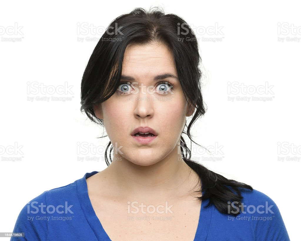 Nervous Young Woman Staring at Camera stock photo