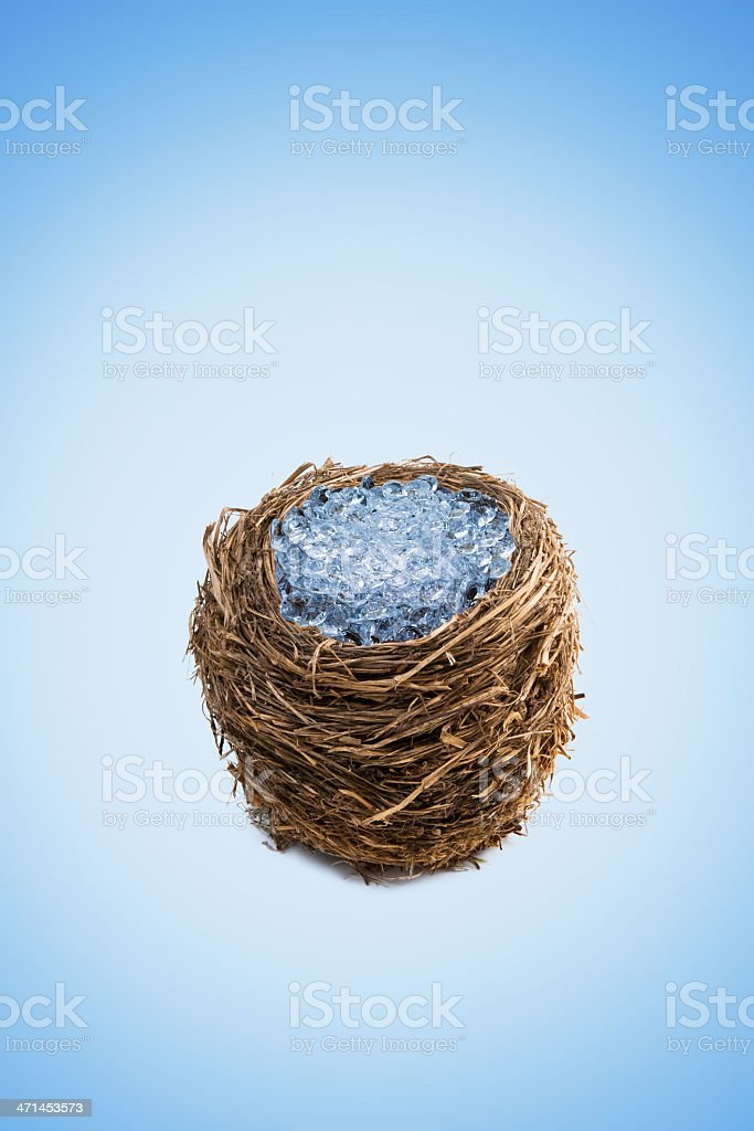 Nest egg filled with brightly lit diamonds royalty-free stock photo