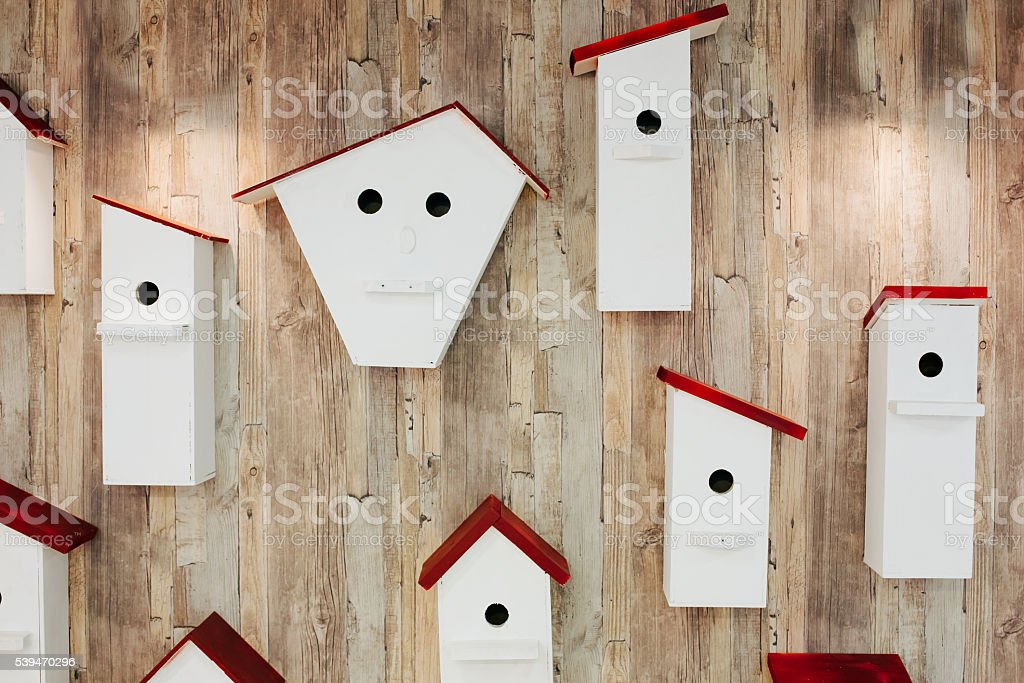 Nesting boxes on the wall. Neighborhood and property concept stock photo