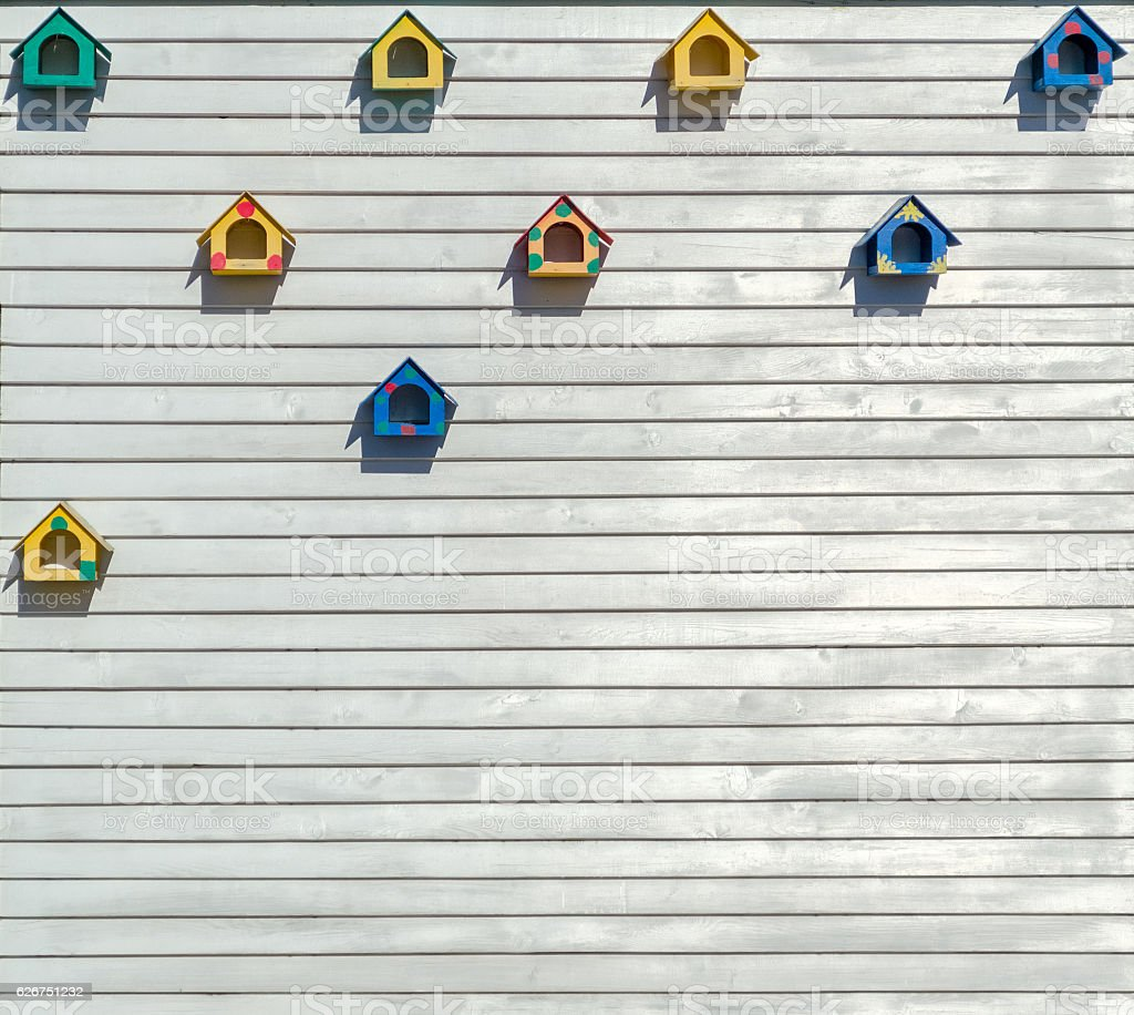 Nesting boxes on wooden plank stock photo