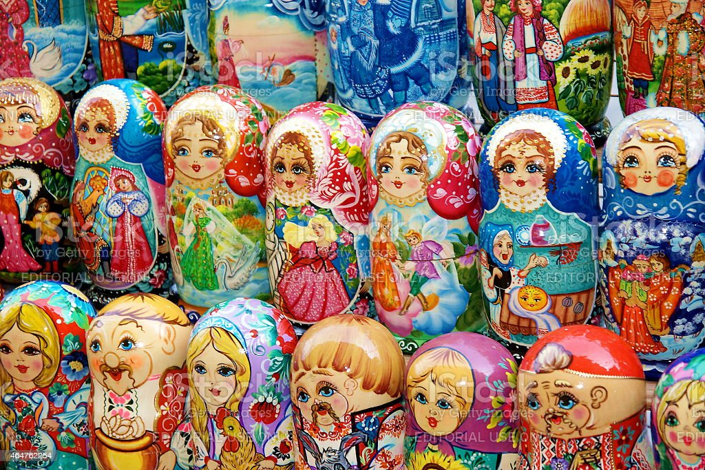 Nesting dolls in national costumes on a souvenir market o stock photo