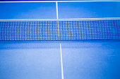 Net on blue ping pong table