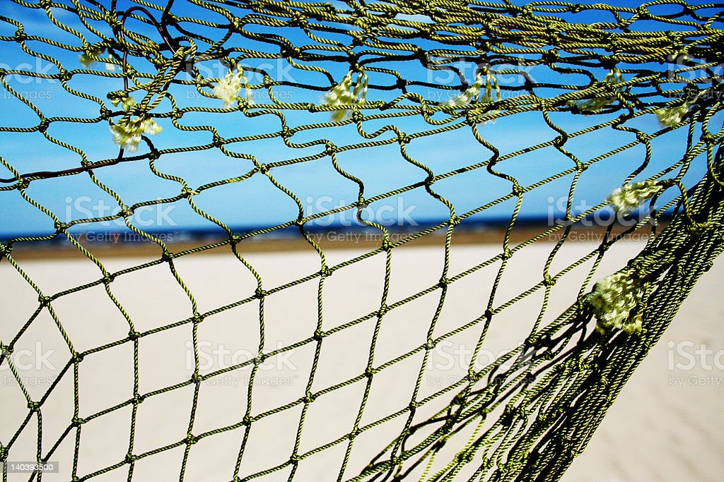 Net on the beach royalty-free stock photo