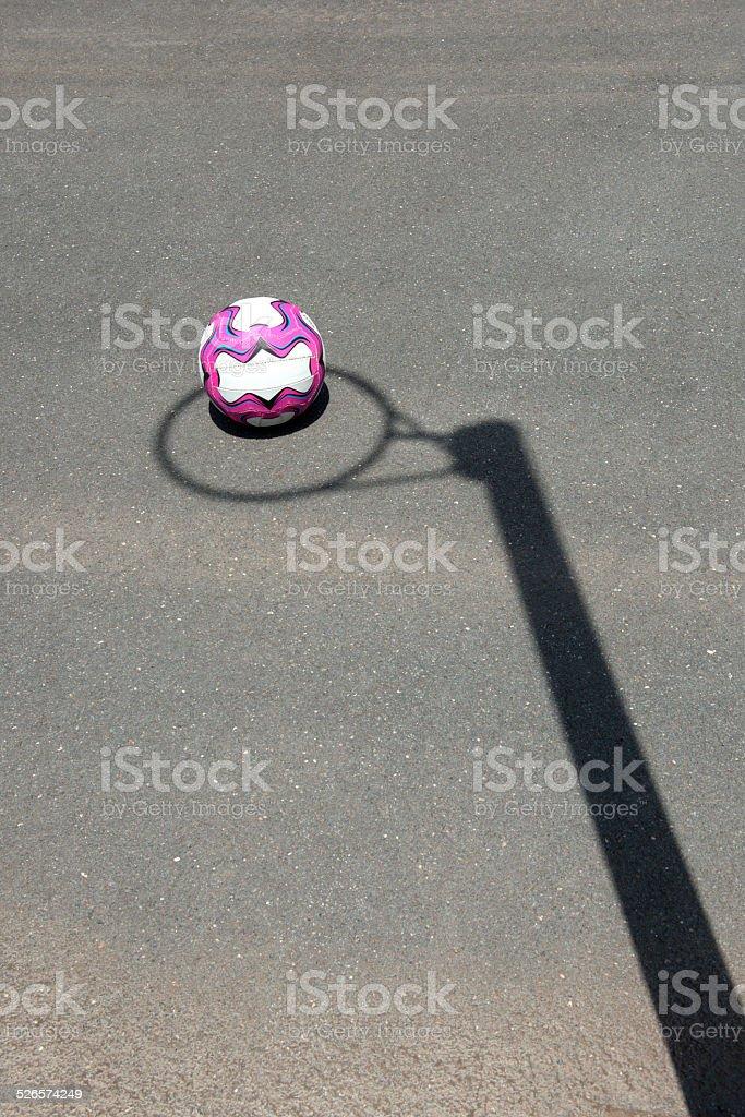 Netball goal post shadow. stock photo