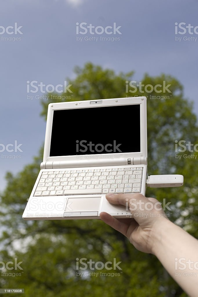netbook with the modem in a hand stock photo