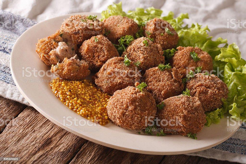 Netherlandish cuisine: meat balls Bitterballen and mustard closeup stock photo