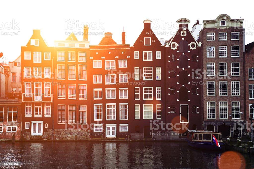 Netherlands Amsterdam Damrak canal old house architecture stock photo
