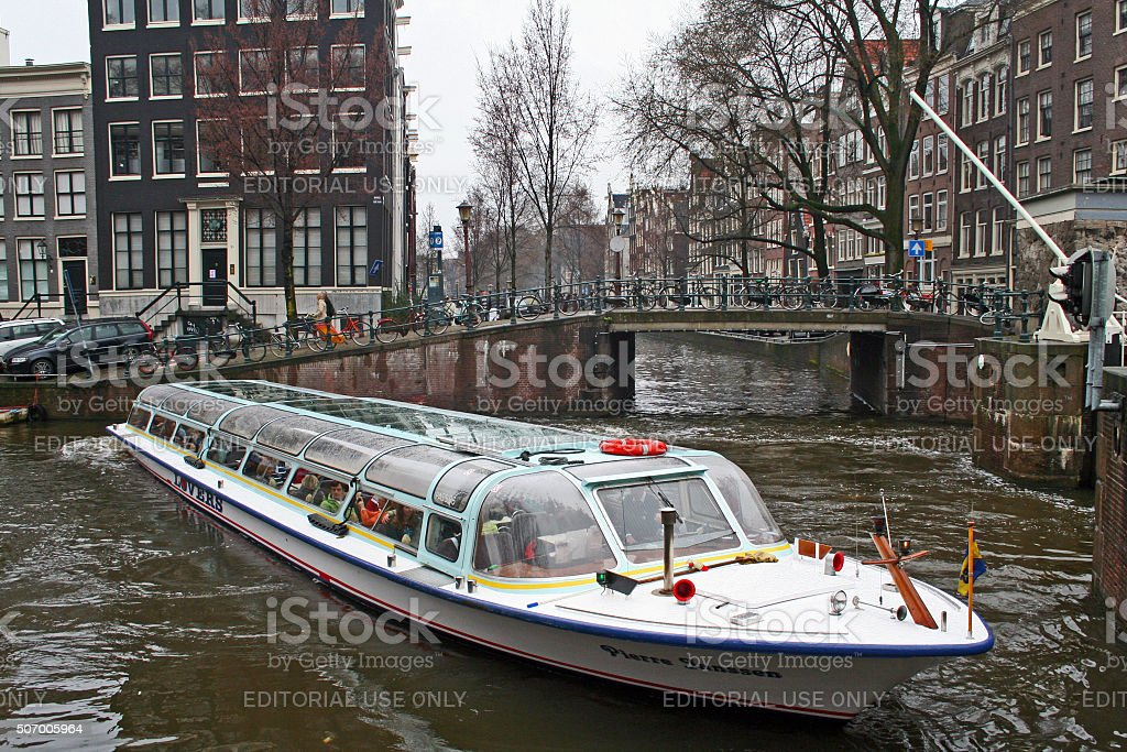Netherlands: Canal Tour Boat on Singel Canal stock photo