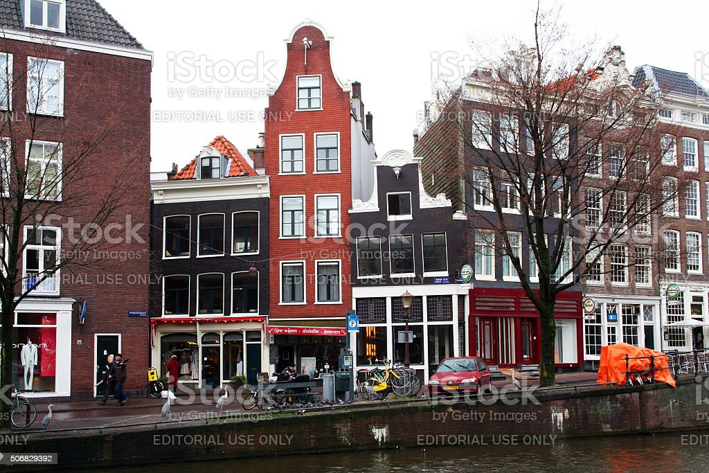 Netherlands: Crooked Canal Houses in Amsterdam stock photo
