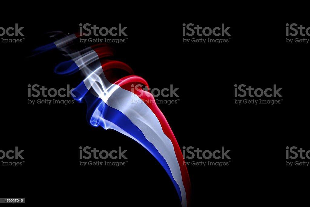 netherlands dutch flag on smoke stock photo