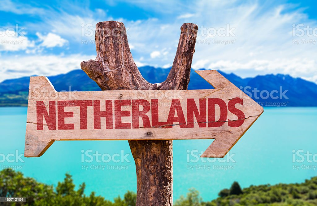 Netherlands Flag wooden sign with river on background stock photo